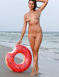 Newcomer Shannon flaunts her sexy body as she plays at the beach.