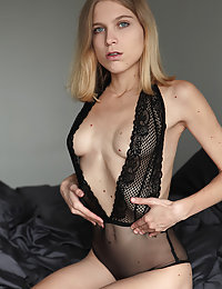 Nora Pace strips her sexy, black lingerie as she flaunts her petite body on the bed.