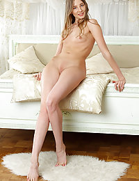 Top model Nimfa bares her tight, delectable body as she strips on the bed.