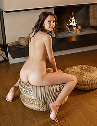 Erna flaunts her tight ass and delectable cookies by the fireplace.