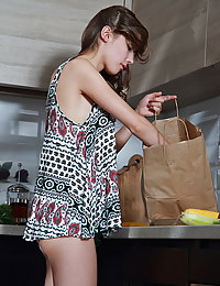 Top model Mila Azul bares her delectable tits and yummy pussy in the kitchen.