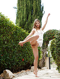 Delightfully cute Nedda A slowly strips naked in the garden before lounging in the couch
