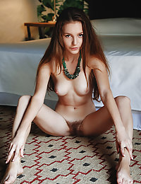 Sweet-smiling Sofi Shane spreads her legs and proudly flaunts her fuzzy, unshaved bush
